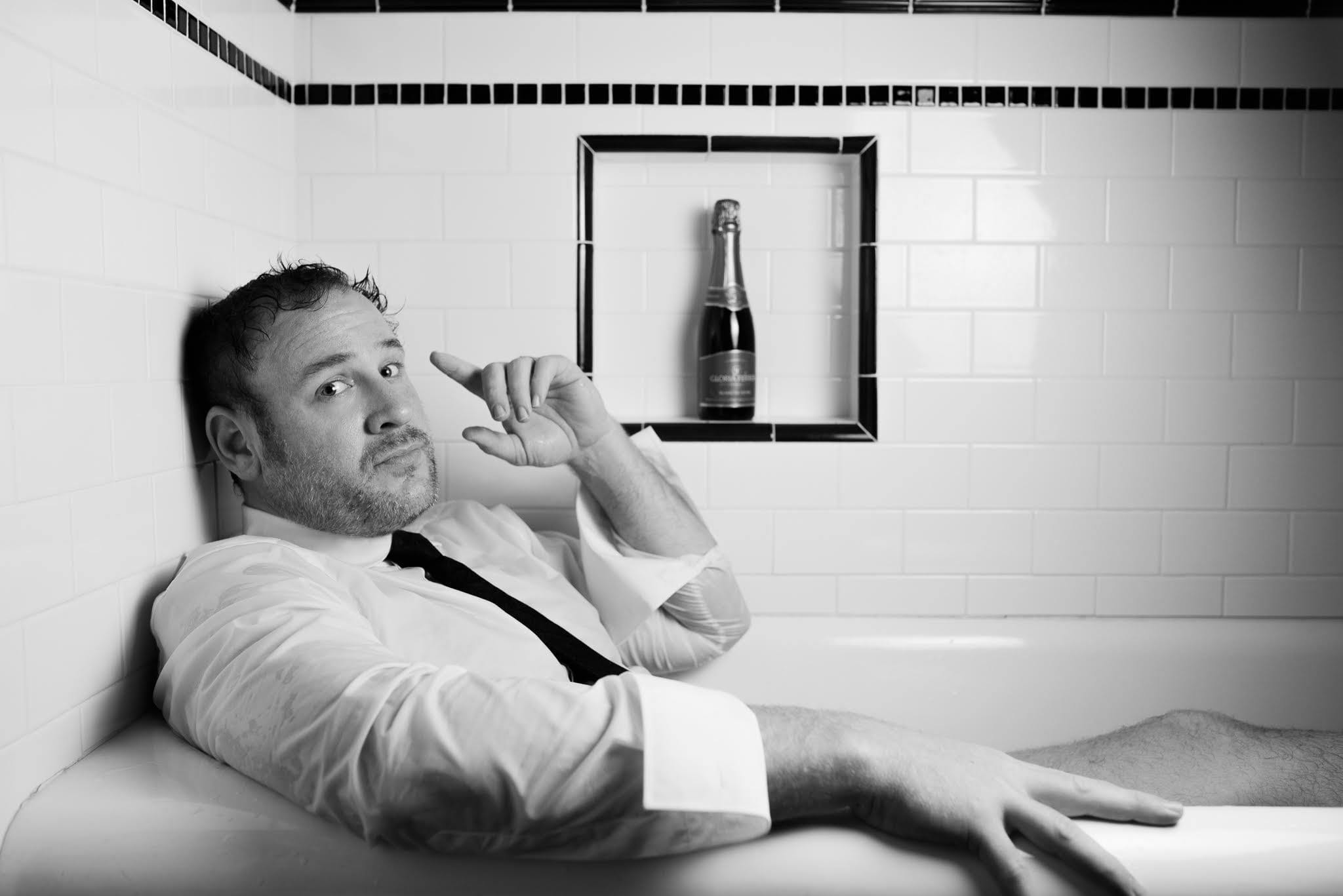 Lucas Meachem in the Bathtub with Champagne
