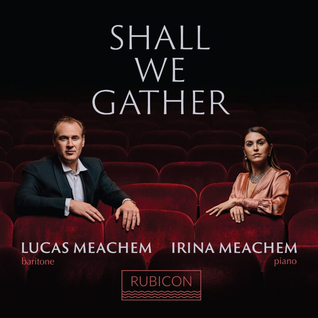 Shall We Gather, solo album by Lucas Meachem, showing Lucas and Irina Meachem sitting in a dark theatre.
